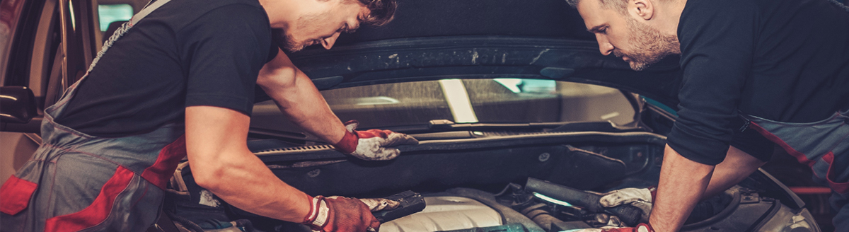 Technicians servicing a vehicle - Servicing Selly Oak
